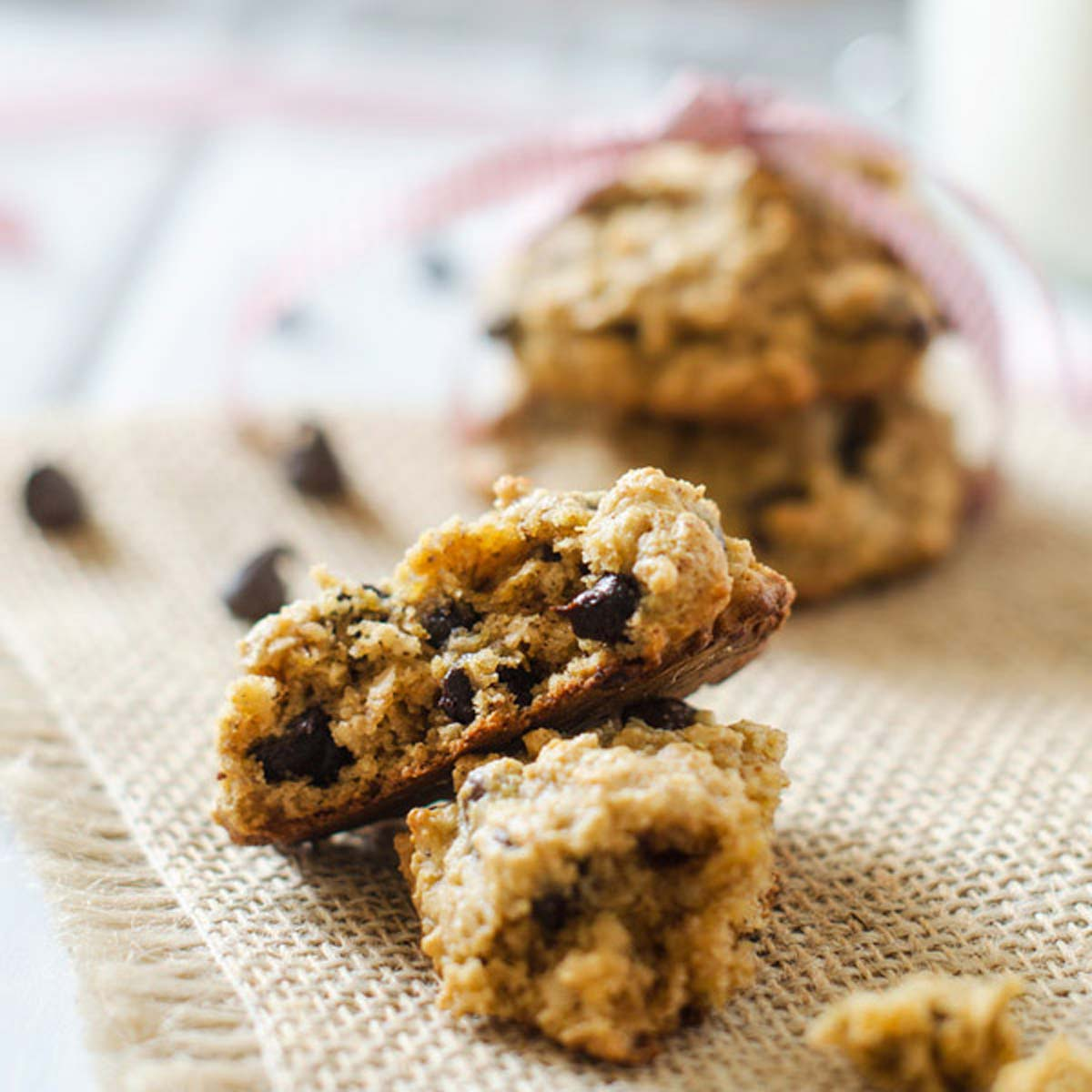 Square close up photo of chocolate chip quinoa cookies on burlap.